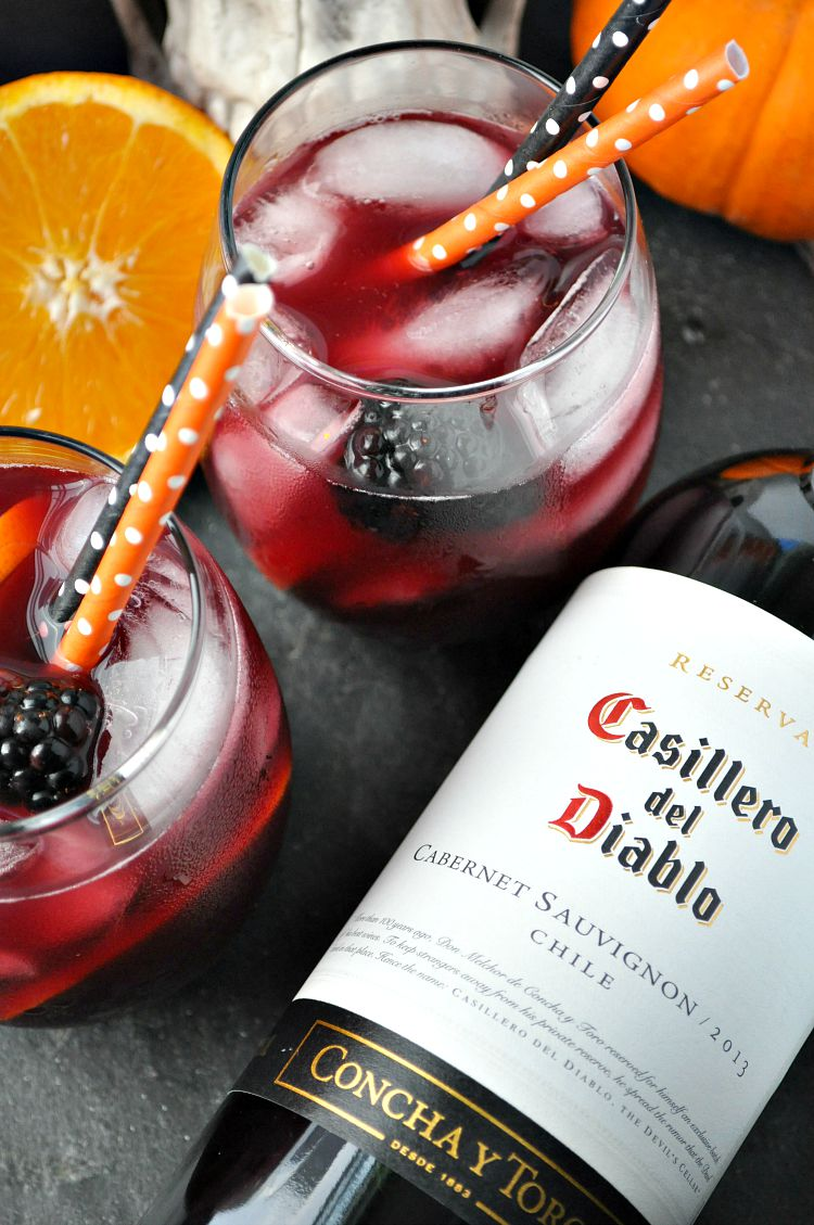 Image via The Seasoned Mom For the annual Halloween Punch, why not try a brooding red wine sangria? Though the recipe calls for Casillero del Diablo a.k.a. The Devil's Cellar, any red wine will do. If you prefer sweet, go for a fruitier red.Want your sangria to have a little more bite, try a drier wine style. No matter what, this sangria is sure to get the party started!