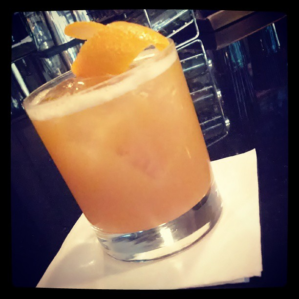 The Back Porch - bourbon, passion-peach puree, ghost pepper, sugar, soda, lemon twist (at Quench)