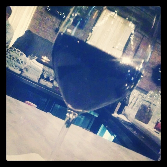 A glass of '09 Priorat. *and Alpana MS is at the end of the bar!!!* Of course this wine is delish… Earthy w/ dark fruit (at The Boarding House)