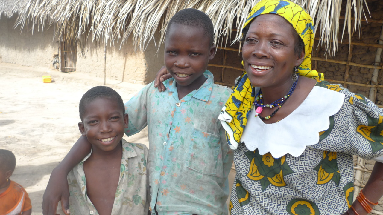 "The number of children in our Orphaned and Vulnerable Children Project has risen again. Rema is now caring for 124 children, two of them pictured here with ""Mama Wanuwiyatima"" (mother for the orphans) herself."