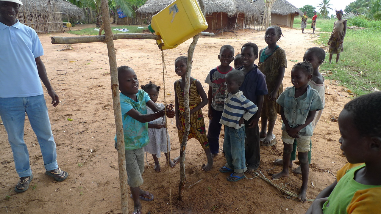 "Kids in Muituro village using the ""tip-tap"" hand washing system Manuel and Manureira have been show-casing in our Hygiene and Sanitation project"
