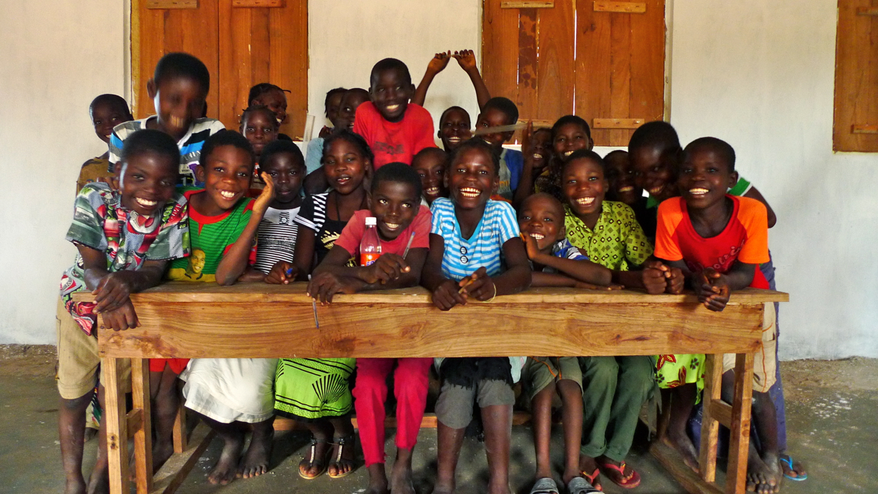 VERY exciting news – now the Ningaia school has been built the government have expanded the school from 4 years to 5!! The children in 5th therefore don't need to walk 2hours to school anymore!! Here are some of the children in 5th year sitting at a school desk for the FIRST time ever!