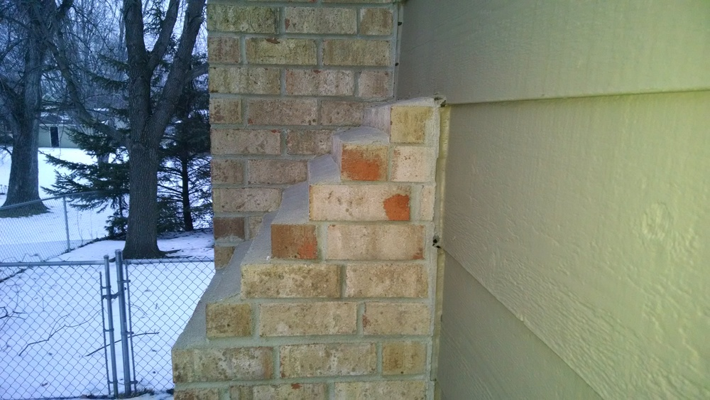Clear signs that a chimney is leaning away from the house.