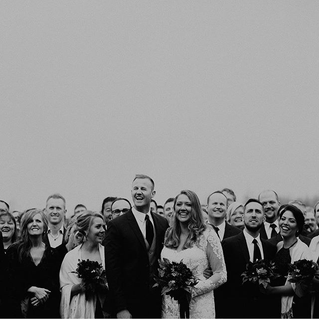 Outtake from a group photo of all their wedding guests post ceremony 🖤