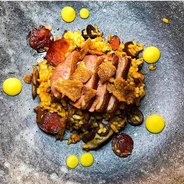 Some things never grow old... The Arroz De Pato, a sort of Portuguese Duck Paella, is a dish that defines the flavors of chef @geomendes' childhood and of Aldea. This traditional and wholesome recipe is an all-time favorite and has been on the menu since Aldea's inception (📸: @domnthecity) #aldea #arrozdepato #portugal #portuguese #cuisine #food #nycdining #newyorkeats #duckrice