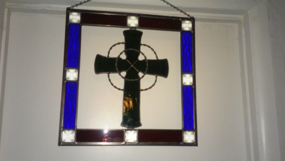 Some artists will bring special, Irish-themed artwork to this Friday's Chandler Art Walk. Pictured is a Celtic Cross stained glass art by vendor Desert Stained Art.