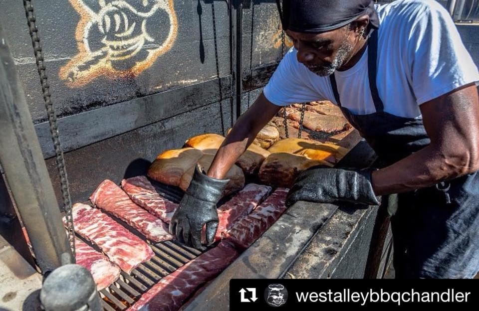 """West Alley BBQ - Tennessee-style barbecue was started in Memphis and features vinegar-based sauces. All of our barbecue is cooked outside, in a pit, on Kingsford charcoal. Jim """"J.D."""" Dandy is the company's pit boss, with more than 30 years' experience. He was the one who cooked almost 1,000 pounds of meat for customers during the BBQ festival. Their plates were a big hit."""