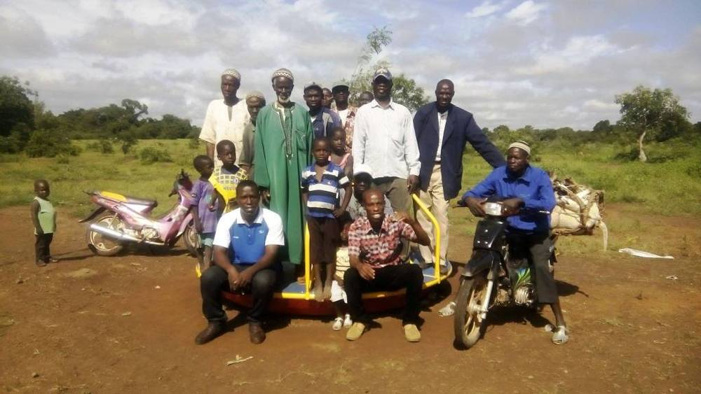 EPI Employees George and Isaac with Empower Mali and community members and teachers from Ferekoroba