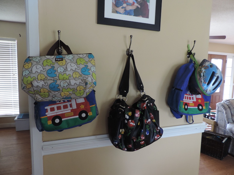 all our bags hanging on hooks.JPG