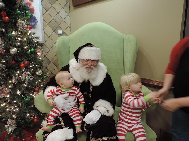 Issie on Santas and ryals lap at cfa 2013.JPG