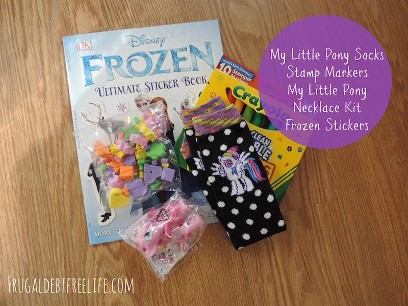 for my youngest niece age 4 i got her some my little pony socks a my little pony toy a necklace making kit stamp markers and a frozen sticker book