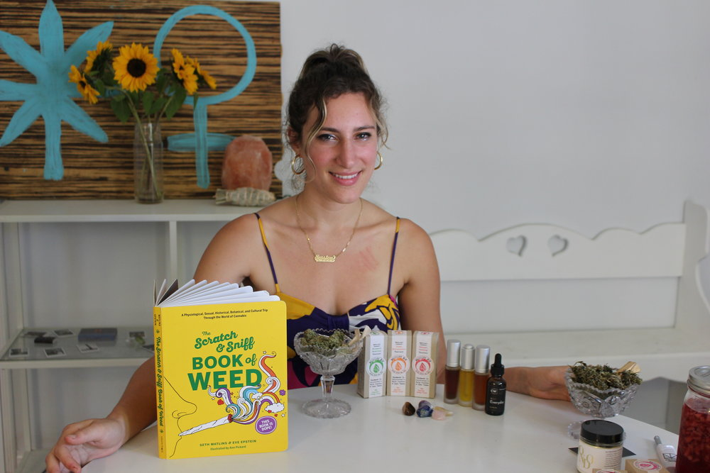 Me at home on 4/20 with my favorite things: The Scratch and Sniff Book of Weed, Medicine Box tinctures, Magu Beauty oils, CW Hemp oil, and Mondo.