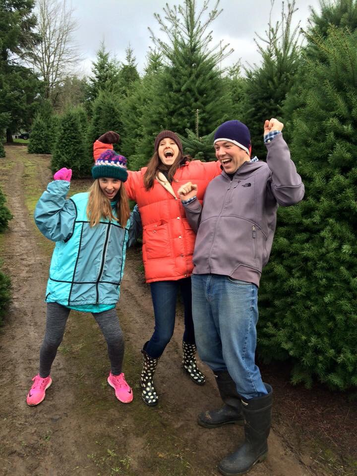 My niece, husband and I celebrate finding the perfect tree.