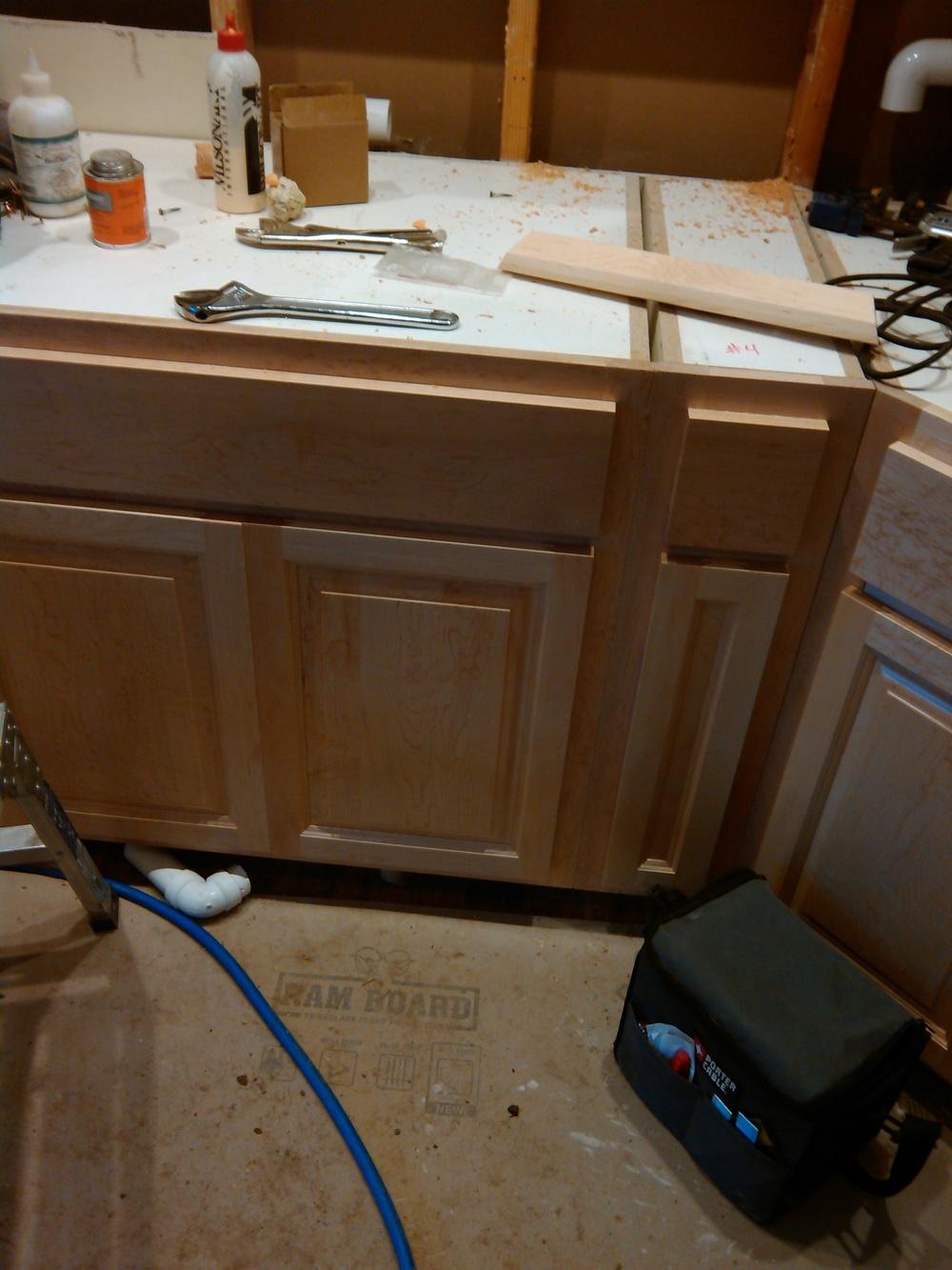 Custom cabinets installation after finish - Key Peninsula