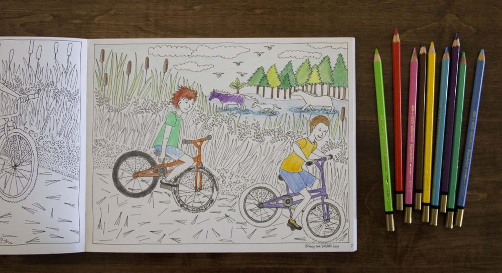 """A partly-colored """"Biking the Wildlife Loop"""" page"""