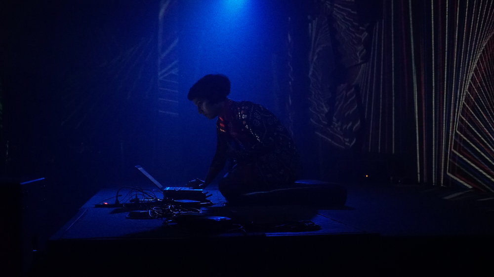 "Kiran Bhumber setting up for ""Hollow Vertices"" performance at Khar Social"