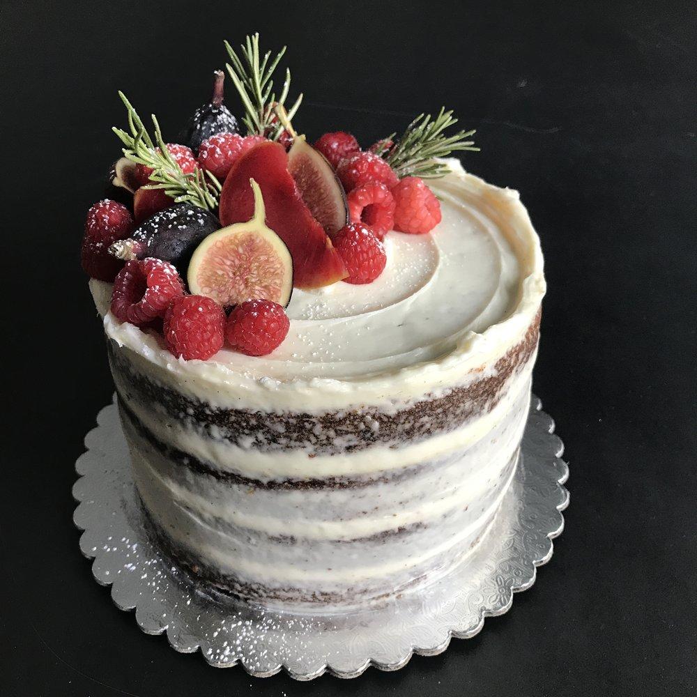Carrot (Standard) - organic carrot cake, rum-soaked raisins, meringue buttercream, seasonal fruits (vary)
