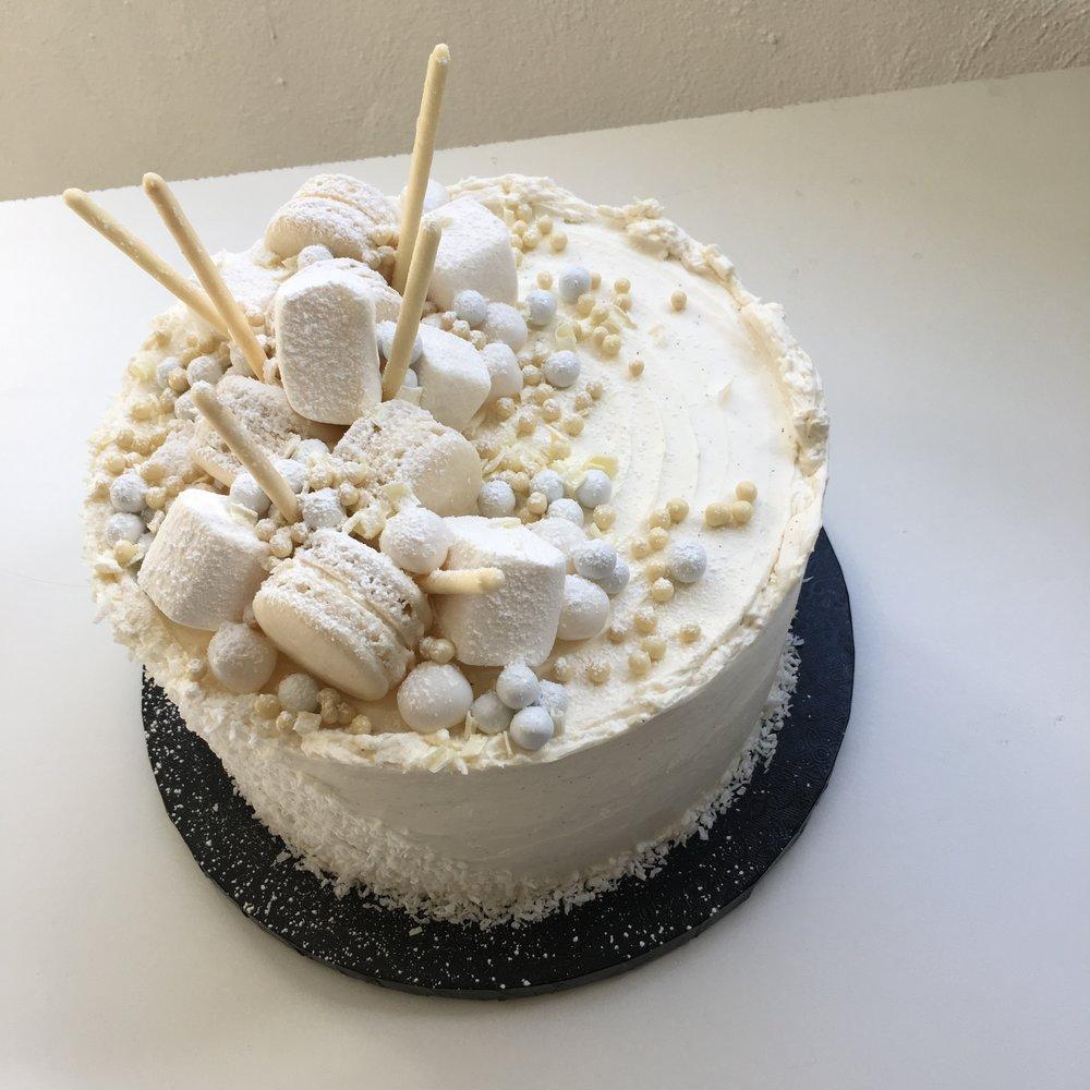 Vanilla (Standard) - vanilla bean sponge, vanilla bean buttercream, assorted artisan candies & meringues (vary)