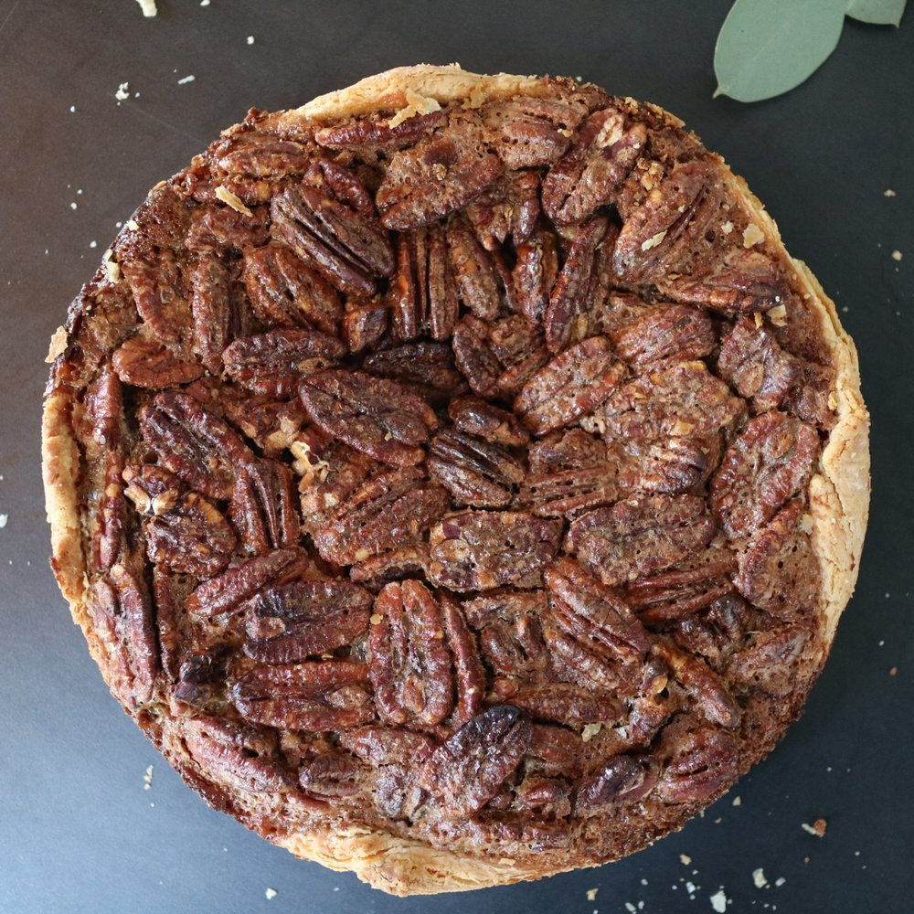 Whiskey Maple Pecan Tart - our signature take on a southern classic, made with organic, pure-maple syrup custard flavored with local High West Whiskey, filled with toasted pecans and warm spices, baked in our classic butter tart shell... 8