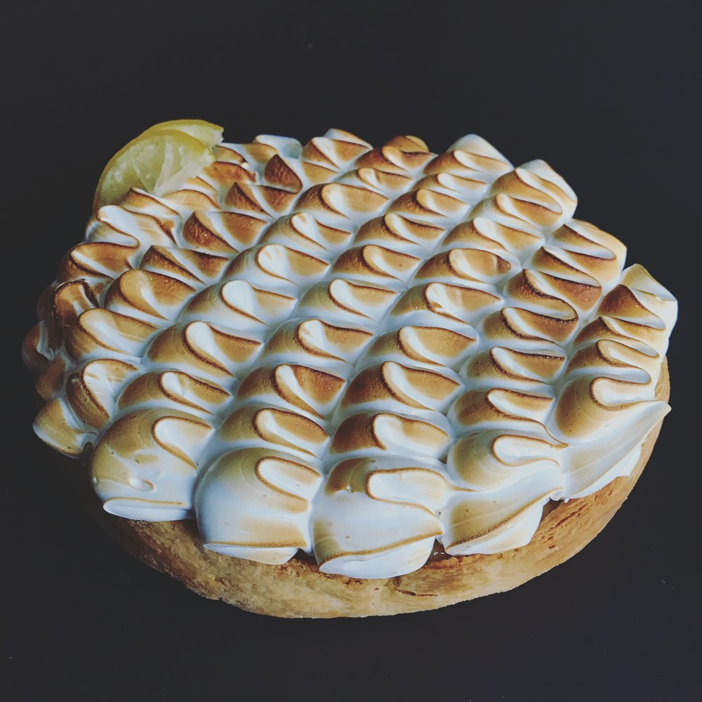 Meyer Lemon Meringue Tart - sweet, tangy Meyer Lemon custard fills our flaky butter tart shell, topped with a creamy vanilla scented meringue, lightly toasted and garnished with house-made candied lemon wheels...8