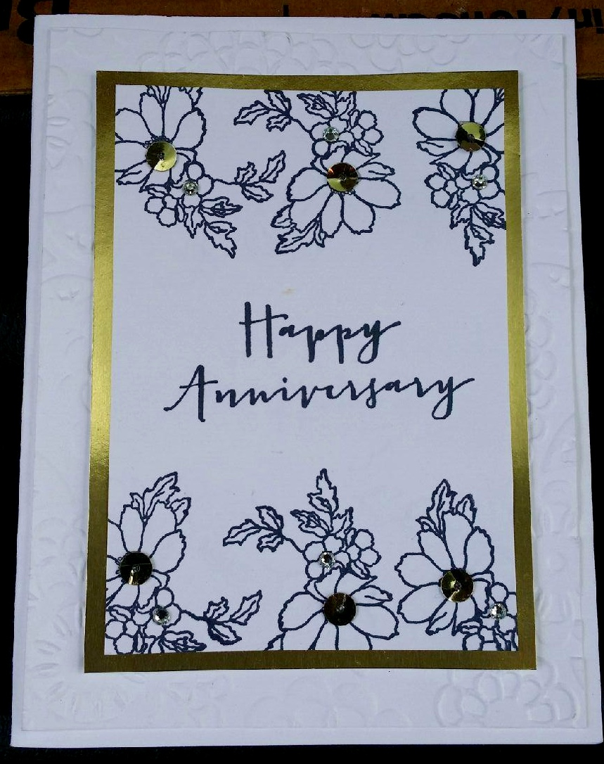 This anniversary card was my favorite of this month's stack.  It was created using the Timeless Love stamp set and is embellished with gold sequins and jewel rhinestones.