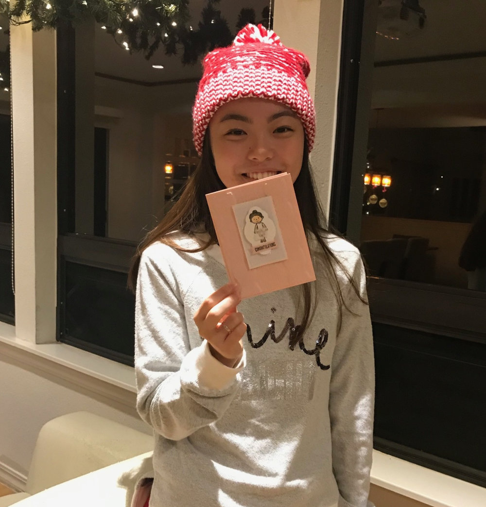 Aria with her card