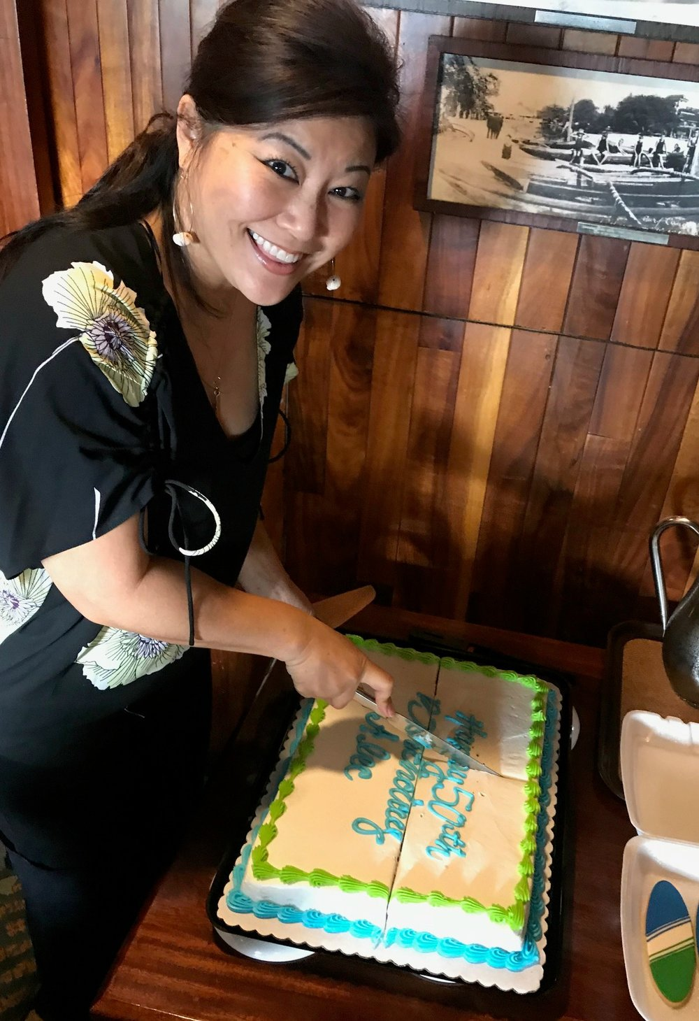 Cindy cuts the cake