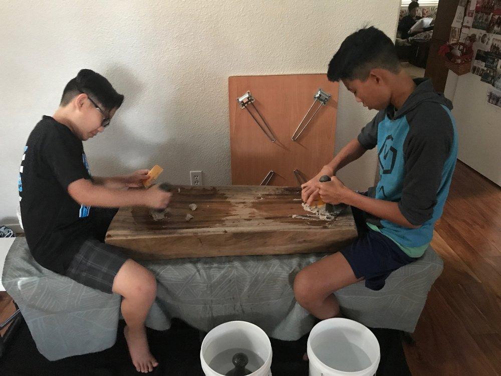 Noah and Daniel pounding taro
