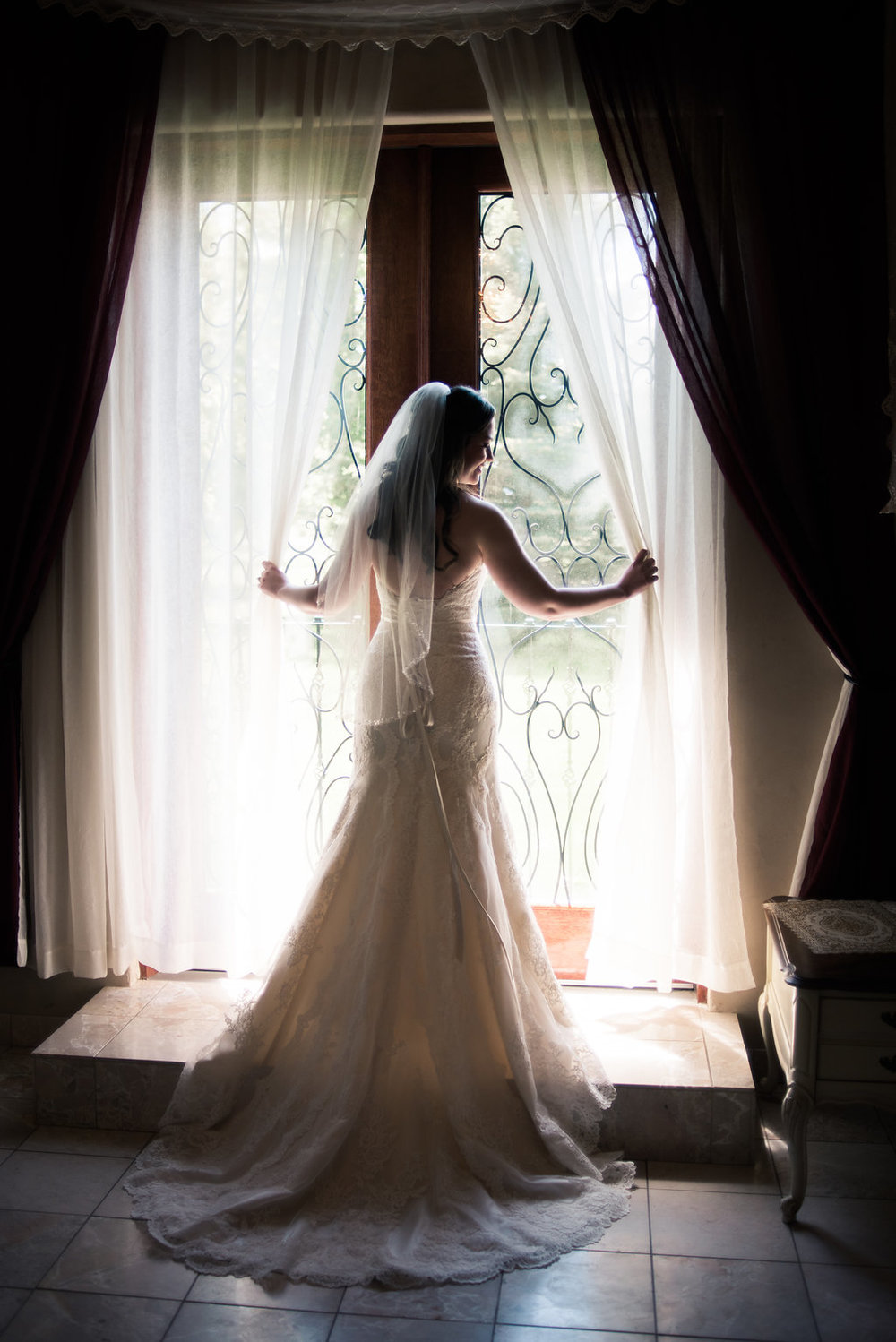 The beautiful bride getting ready at Le Petit Chateau in Bozeman.