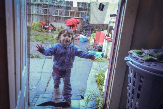 Dominique, 2, walks in the door of his home on the outskirts of San Francisco, CA.