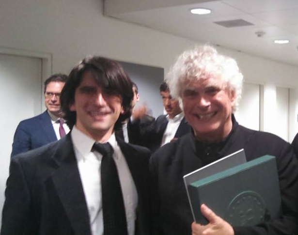 Want proof that I'm doing it right? I took part in a performance of Luciano Berio's epic and rarely performed piece, Coro in Lucerne, Switzerland during the summer of 2014—a year after I finished graduate school—conducted by Sir Simon Rattle of the Berlin Philharmonic. This is a picture of us after the show. It was an opportunity of a lifetime to work with an amazing human being. He even came out to the bar with us after and insisted that he conduct the singing of Happy Birthday for one of the orchestra members. It was an amazing trip and I wrote Make It so you can have your own.