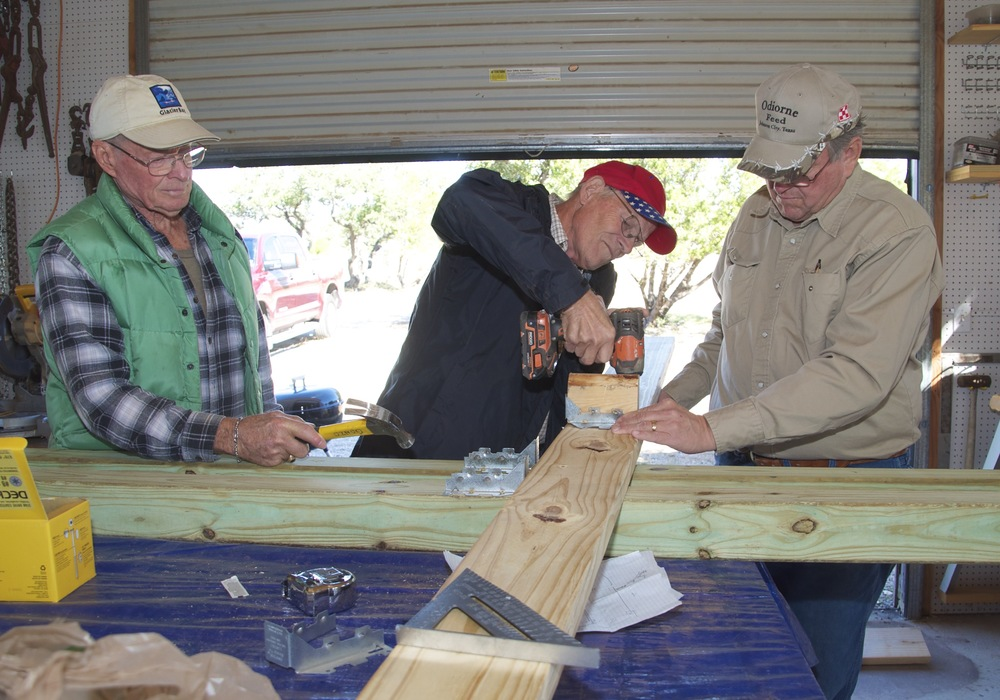 Blanco County's wheelchair-ramp-builders are now building storage sheds for flood survivors who need a place to secure belongings they've recovered, and will soon need safe storage for tools and construction supplies as they rebuild. The materials for the 8x12 sheds cost $900 each, but with donations from generous supporters the team is providing them free to survivors of the storms. These workers are, left to right, Tom Hardy, David Hamm and Johnson City United Methodist Church Pastor Lee Romero.