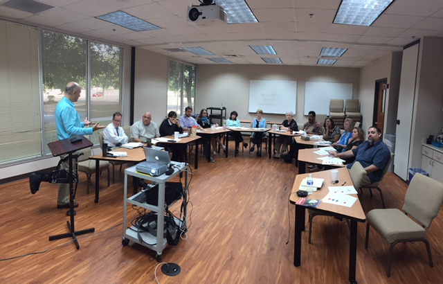 Alberto Garcia-Jurado of cultural system management inc. presents to the Mission Vitality center in san antonio on sept. 22.