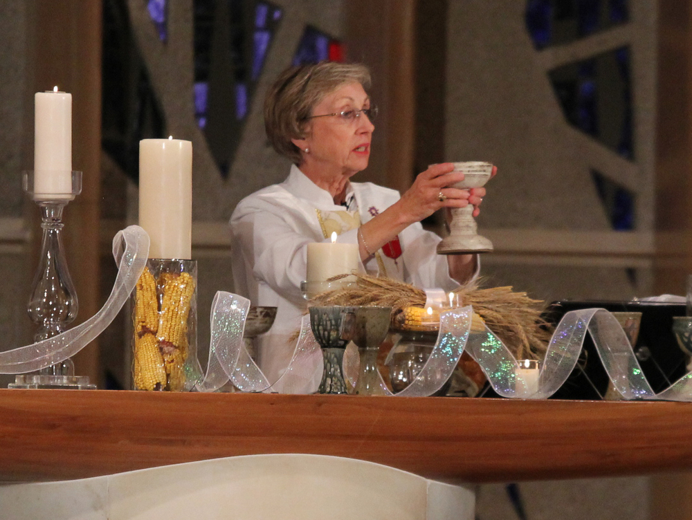 Bishop Janice Riggle Huie presides at the Lord's Table.