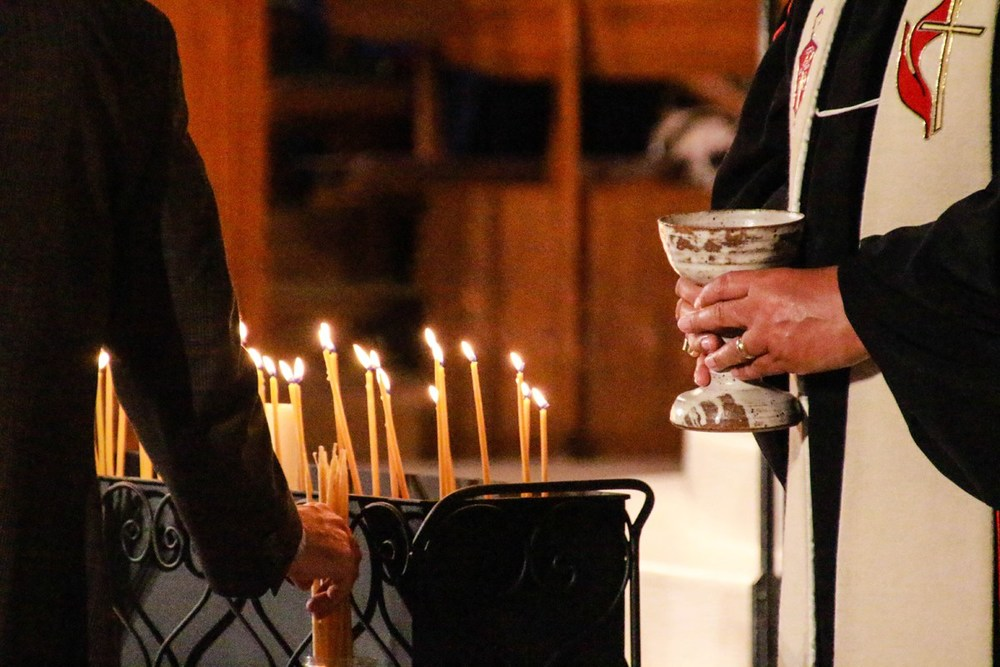 After receiving communion, worshippers were invited to light candles in memory of those who have died this year.