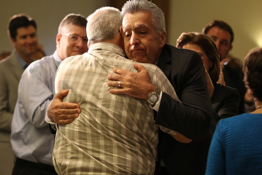Bishop Saenz embraces colleague and friend Abel Vega