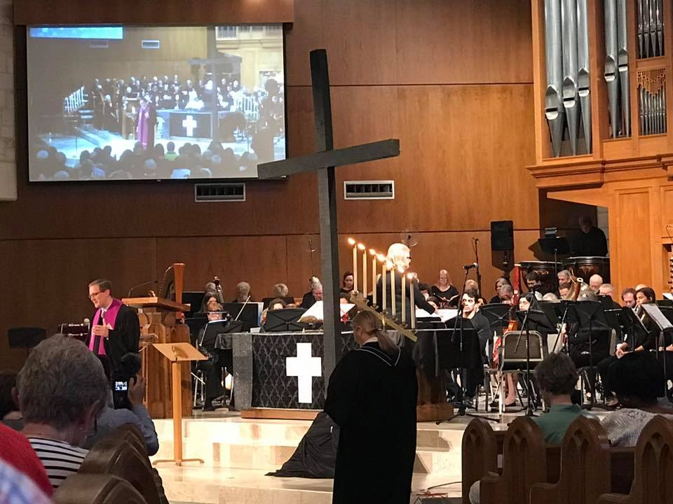 Mary McKay, Director Traditional Worship & Music, leads the choir and orchestra during the Good Friday service.