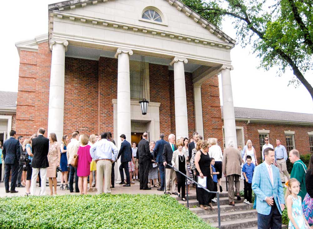 Overflow crowds flow in and out of Tarrytown UMC on Easter Sunday.