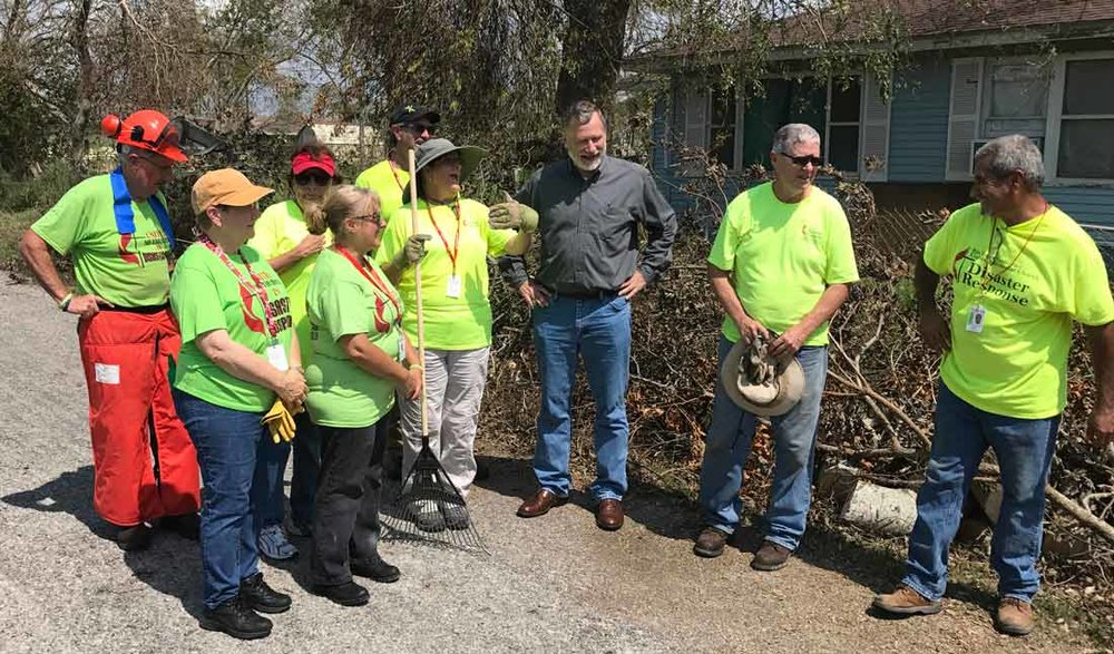 Robert Schnase, bishop of the rio texas annual conference meets with an Early response team and they prepare for work.