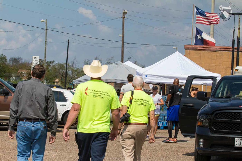 Robert Schnase, Bishop of the Rio Texas Annual Conference; Jim Callis, Corpus Christi Area ERT Site Coordinator; and Eugene Hileman, Disaster Response Coordinator, tour a relief staging area in Gregory, Texas