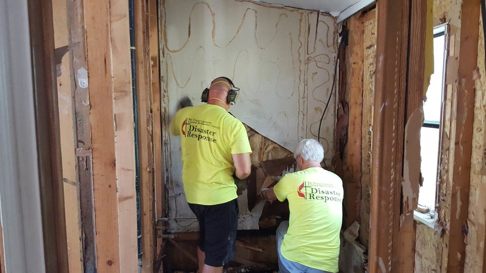 A Rio Texas Early Response Team rips out sheetrock and checks for further water damage. photo: R. Pitzer