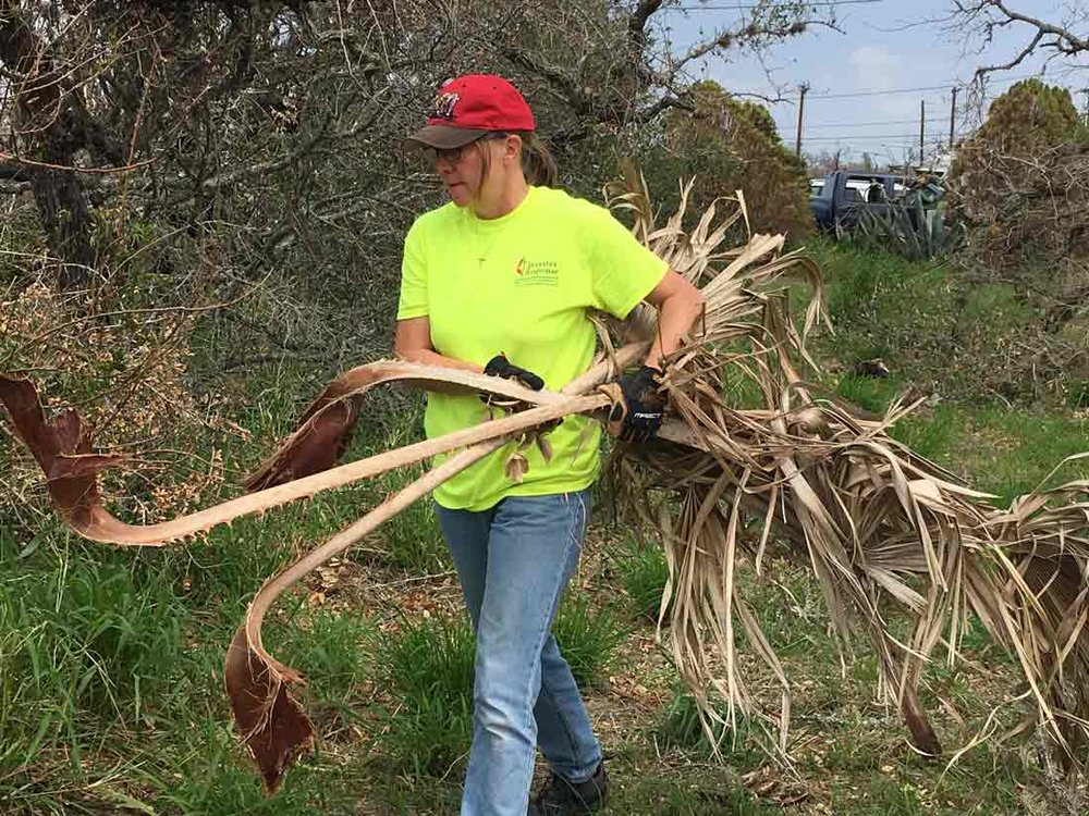 ERTs remove brush and debris to begin the cleanup process. photo: Linda Morrow, Coastal Bend District.