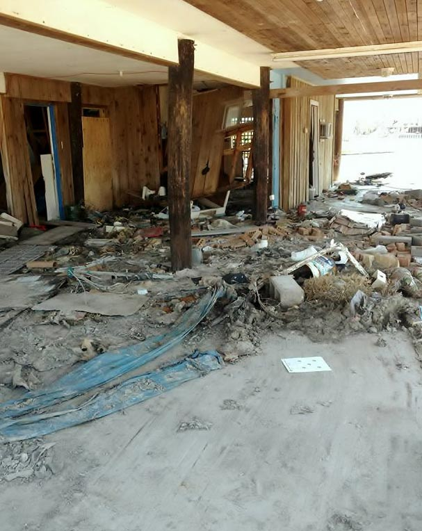 A CARPORT FULL OF DEBRIS IN HOLIDAY BEACH