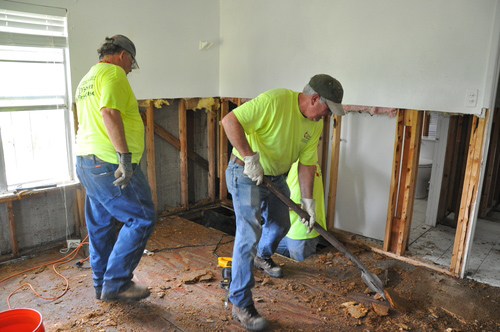 •    ERT volunteers removing Sheetrock and scraping out debris at an affected home