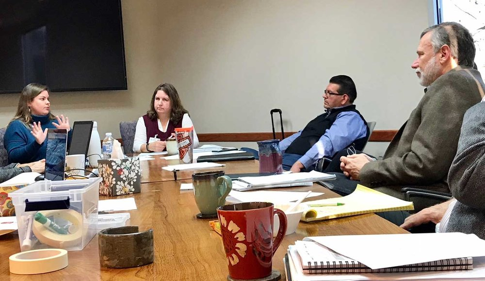 Robert Schnase, Bishop of the Rio Texas Annual Conference (right), and District Superintendent, Rev. Robert Lopez, look on during an update from Nikki Leaverton, Disaster Recovery Director (left), and Vicki McCuistion, Disaster Recovery Asset Manager.