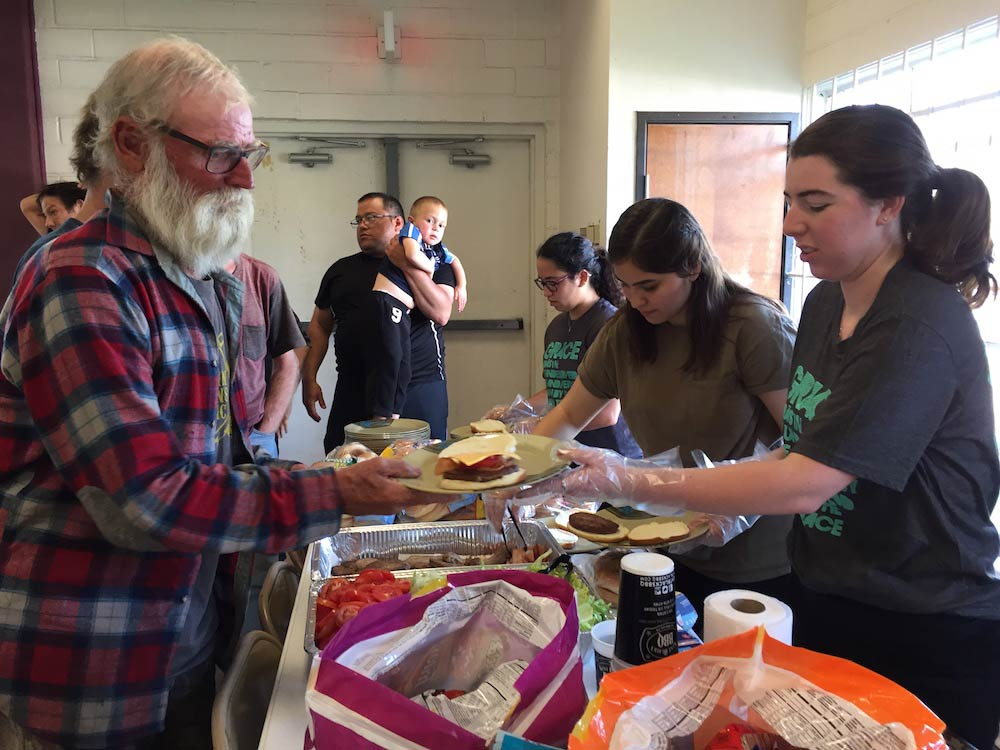 Texas State United Campus Ministry students serve a meal at the San Marcos Southside Homeless Shelter