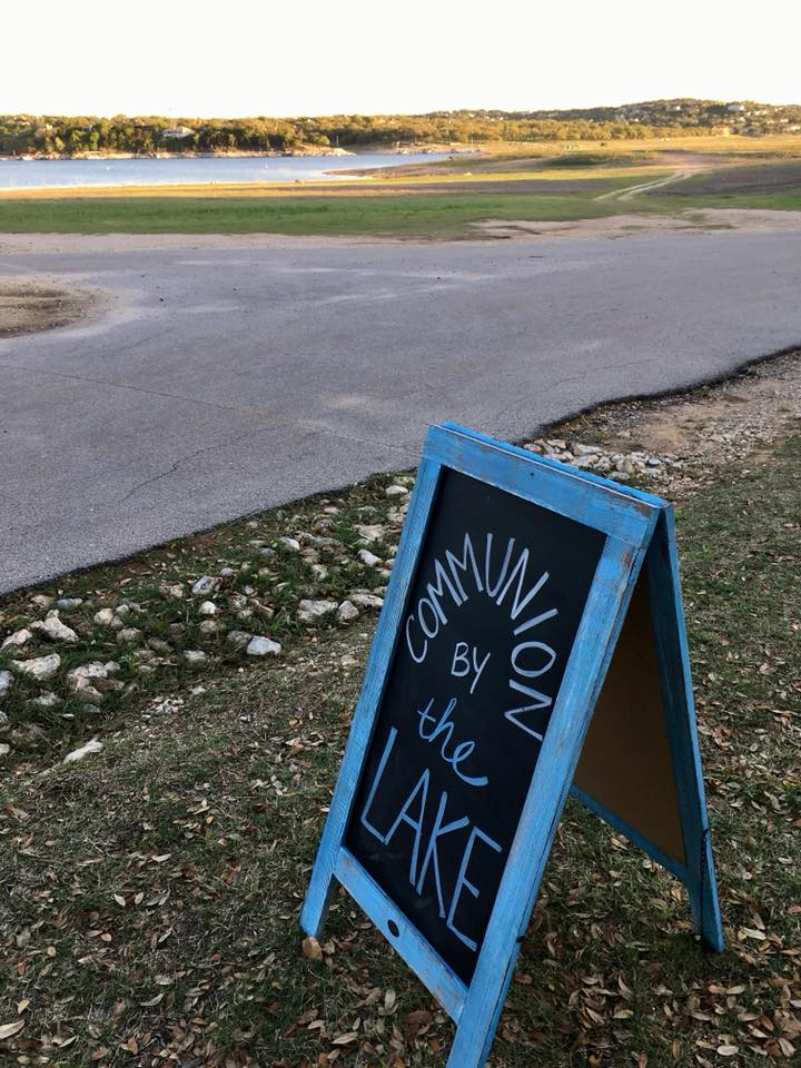 A welcome sign greets visitors to Pace Bend Park for Bee Creek UMC's communion by the lake.