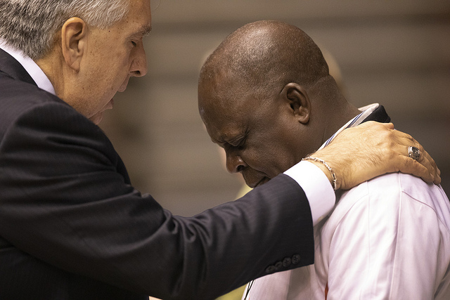 Bishop Ruben Saenz prays with Luka  Bitrus, delagate from Southern Nigeria, during the 2019 Special Session  of the United Methodist General Conference in St. Louis. Photo by Kathleen Barry, UMNS.
