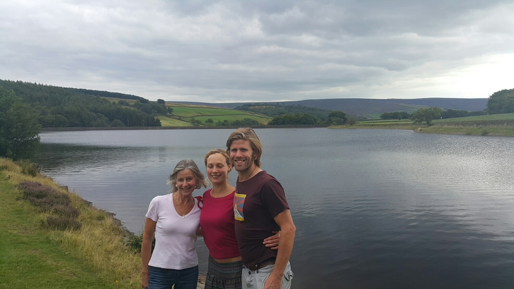 Pete, Alice and Paula  overlooking a water reservoir 5 mins walk from their house.  The peaks away in the background