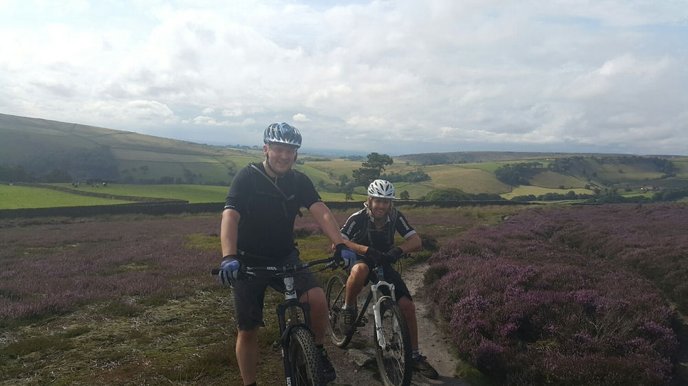 Dave and Pete with the purple flowers out on the Heather.  The heather only flowers for a couple of weeks a year.